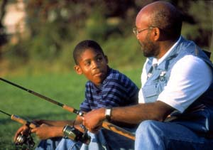 An African-American father and sons fishing.